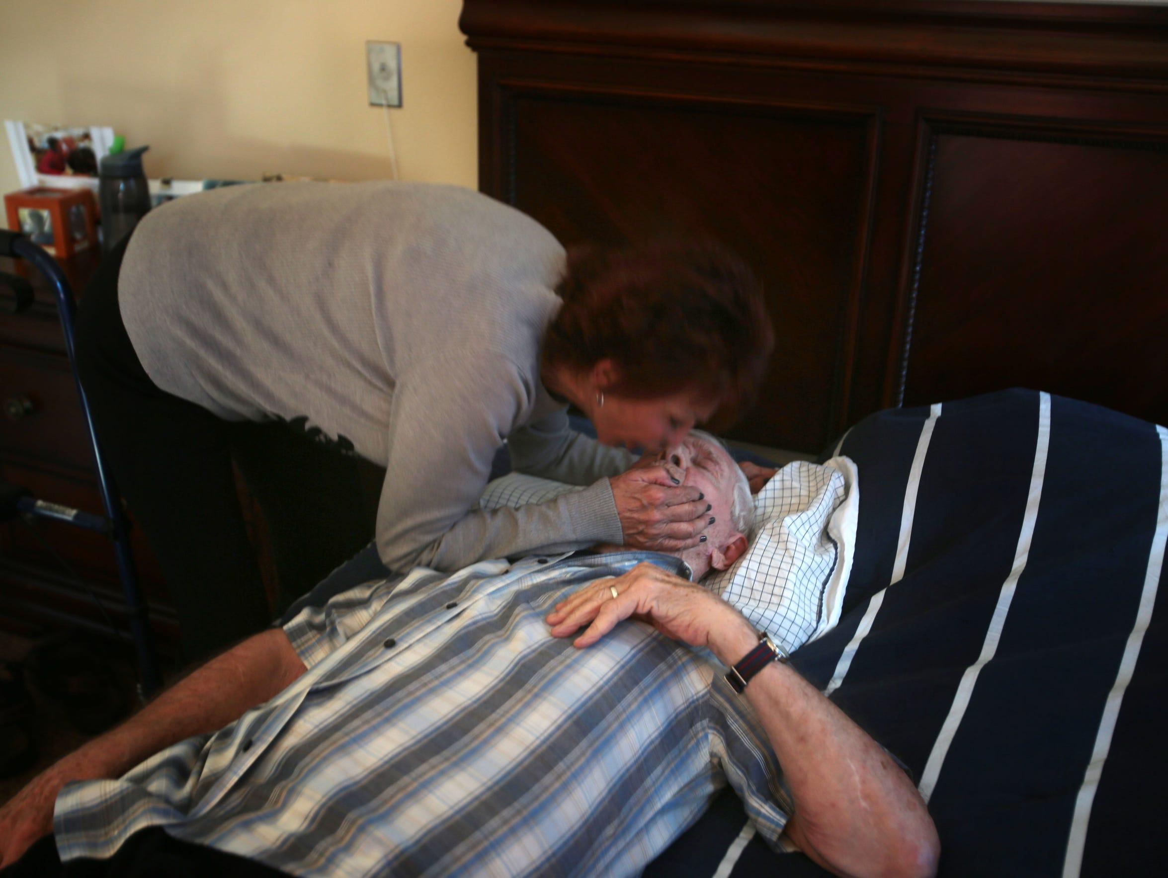 Gail Lansbury gives her husband Bruce Lansbury a kiss