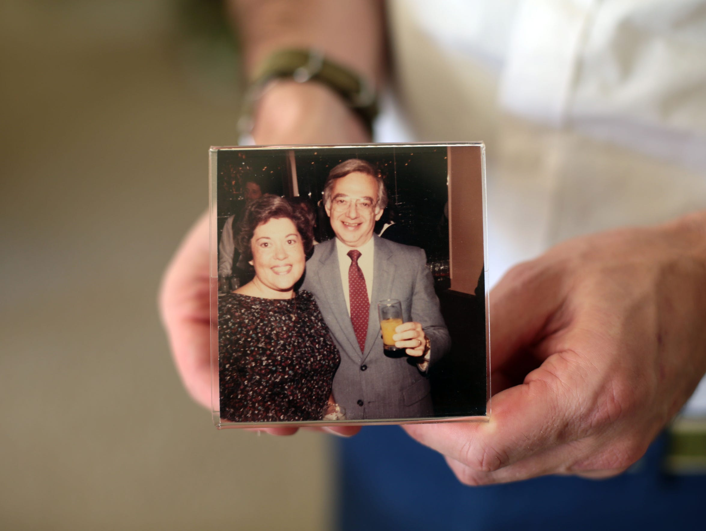 Jerry Sallo holds a photo of himself and his wife Jane
