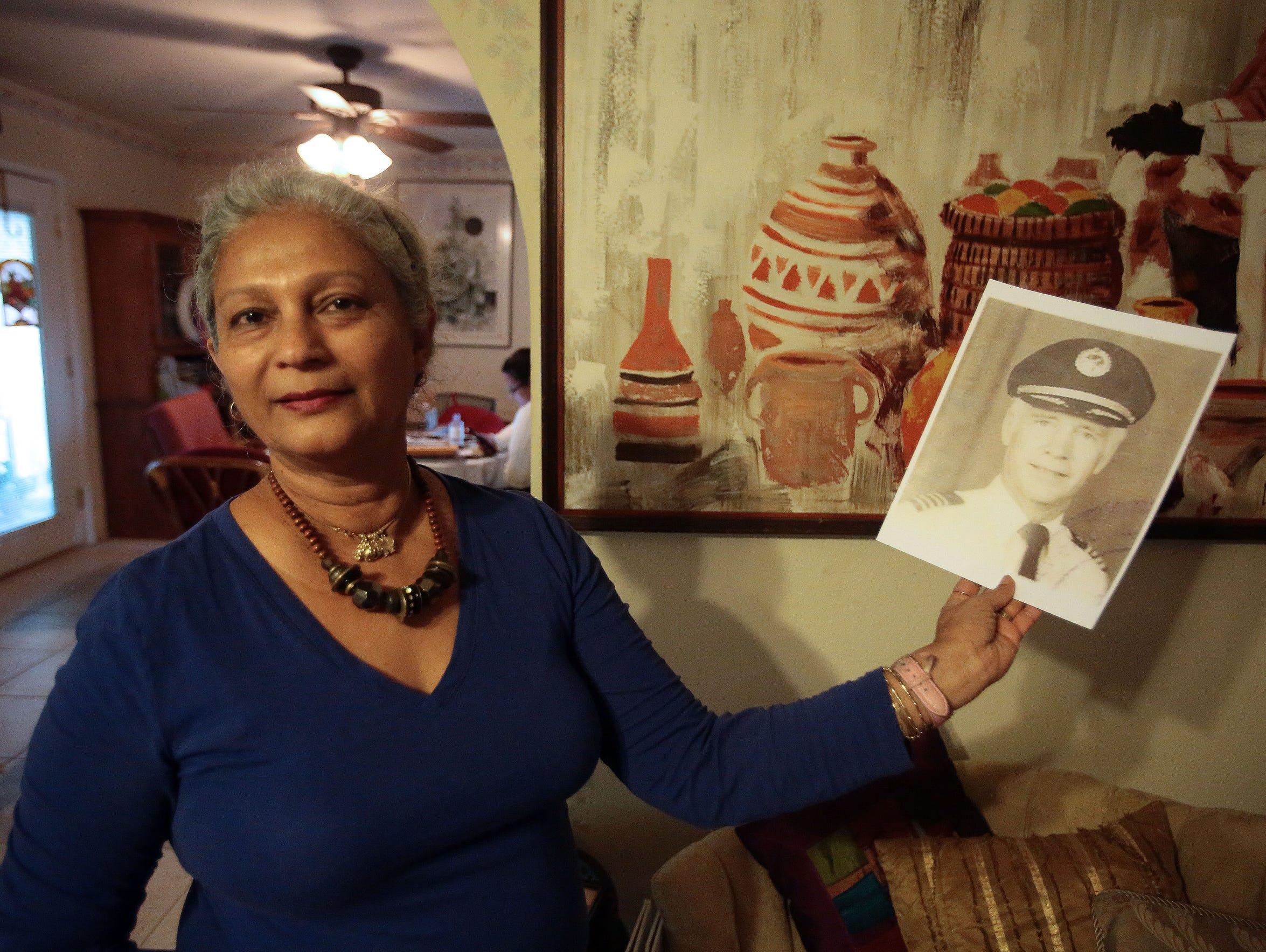 Candi Lindig holds a photo of her husband David Lindig