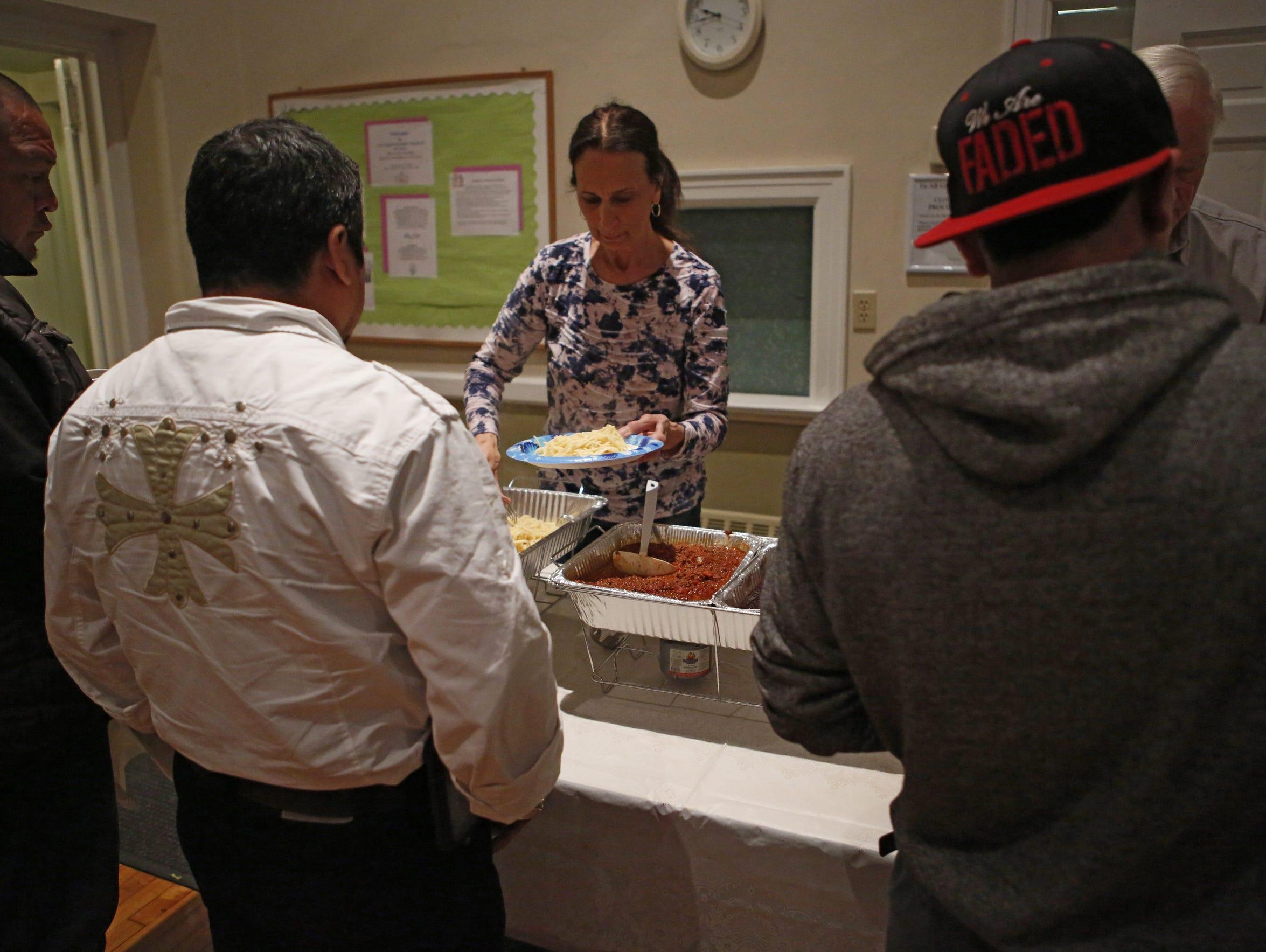 Homeless men grab a hot meal before settling in for