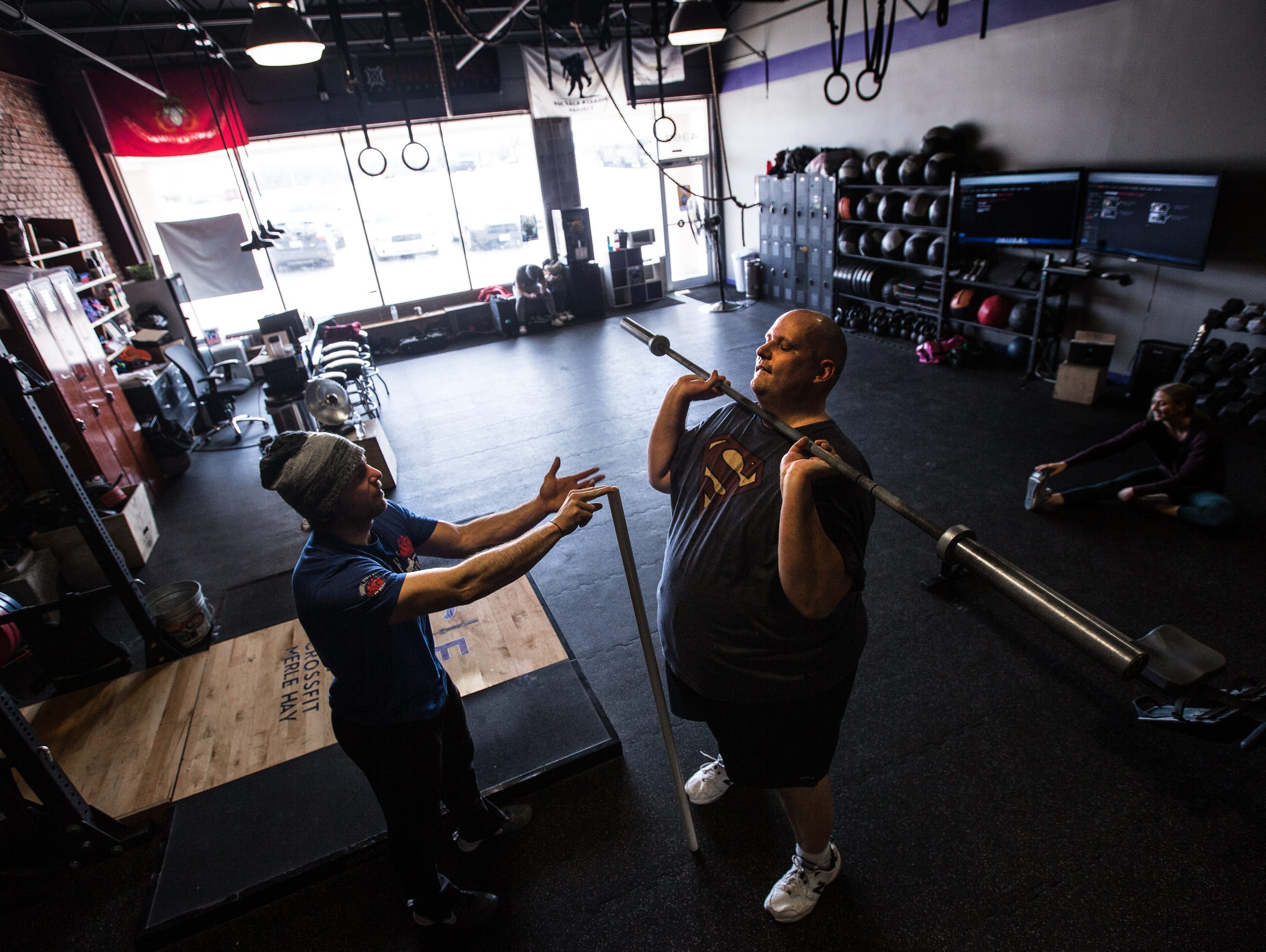 Daniel Finney works with coach Nate Yoho at CrossFit