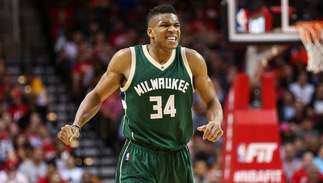 Milwaukee Bucks forward Giannis Antetokounmpo reacts after a play during the second quarter against the Houston Rockets.