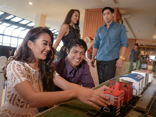 From left, Aiyana Shedd, Peter Carbullido, Shania Mesgnon and Matthew Pangelinan model casual holiday fashion at the Hilton Guam Resort & Spa on Nov. 19, 2016.