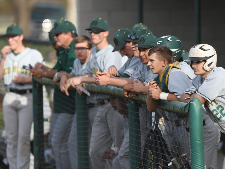 Tanner Tweedt (22) and other Red Bluff baseball players