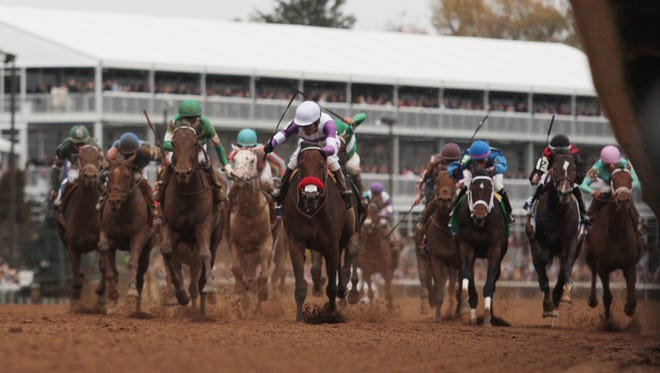 Nyquist, in white and purple, wins the Sentient Jet Breeders' Cup Juvenile at Keeneland. Oct. 31, 2015