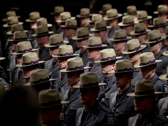 Some of the nearly 230 graduating troopers stand during
