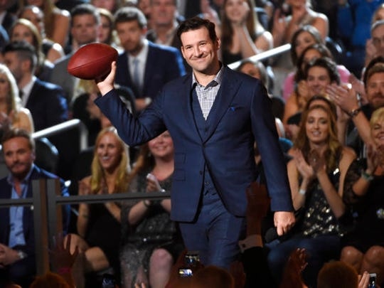FILE - In this April 19, 2015, file photo, Tony Romo walks on stage at the 50th annual Academy of Country Music Awards at AT&T Stadium, in Arlington, Texas. A person with knowledge of the decision says Romo is retiring rather than trying to chase a Super Bowl with another team after losing his starting job with the Dallas Cowboys. The all-time passing leader for the storied franchise is headed to the broadcast booth after considering those offers. The person spoke to The Associated Press on condition of anonymity Tuesday, April 4, 2017, because Romo's decision hasn't been announced.