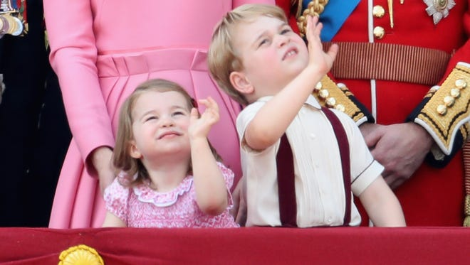 Princess Charlotte and Prince George wave from the balcony of Buckingham Palace during the Trooping the Colour parade on June 17, 2017 in London.