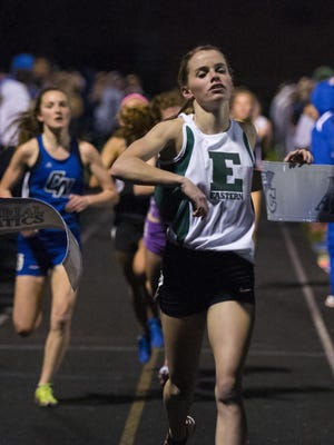 Bethany Neeley of Eastern High School crosses the finish line to win the Mile Run with a time of 5 minutes, 7.08 seconds on Apriil 12, 2013, at the Franklin Central Showcase Invitational in Indianapolis.