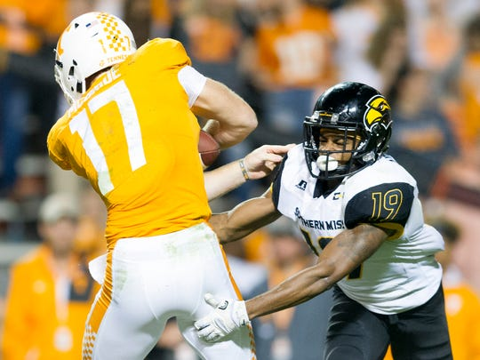 Tennessee quarterback Will McBride (17) is tackled by Southern Miss defensive back Curtis Mikell (19) during an game between Tennessee and Southern Miss at Neyland Stadium in Knoxville, Tennessee, on Saturday, Nov. 4, 2017.