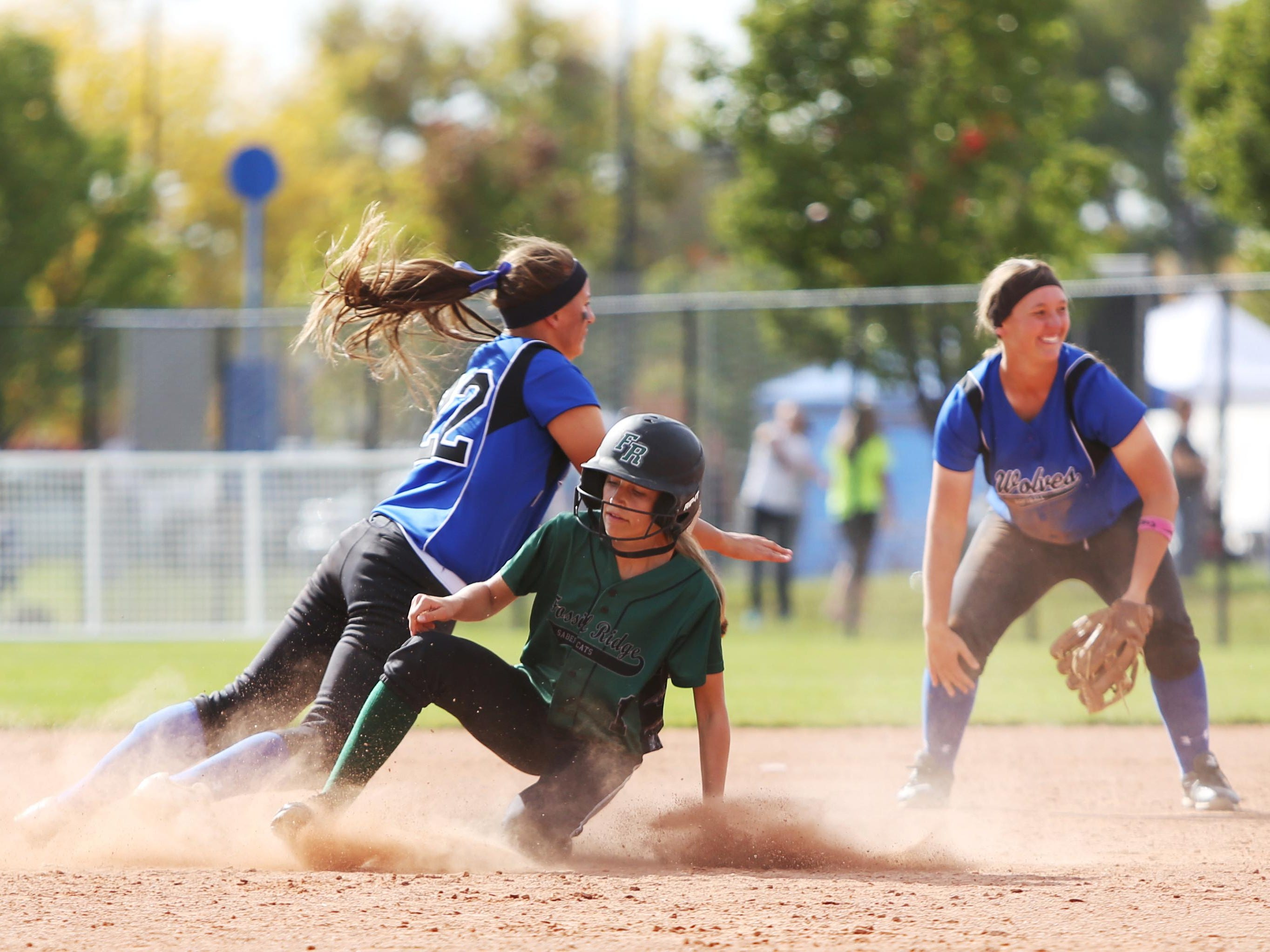 Grace Philop slides into second base during the Fossil Ridge girls softball team State softball championship against Grandview last year. Fort Collins, Fossil Ridge, Rocky Mountain and Windsor all play in the state softball tournament on Friday.