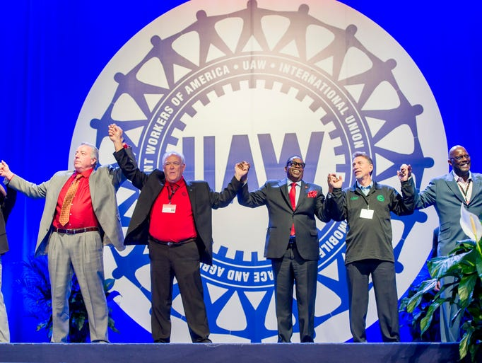 The UAW leadership joins hands and sings 'Solidarity