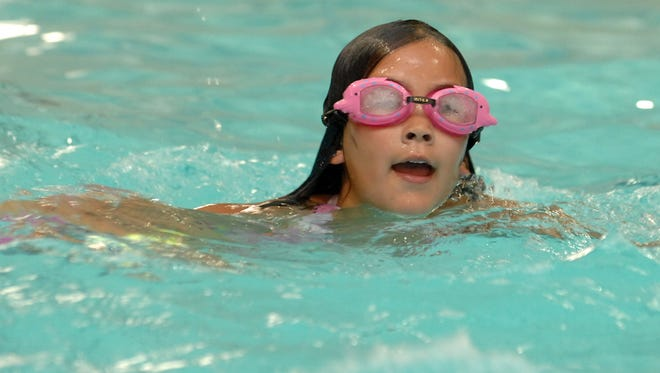 Mikayla Siebert of Wausau plays in pool of the Woodson YMCA  in 2008. The YMCA is hosting its first Youth Triathlon on June 6.
