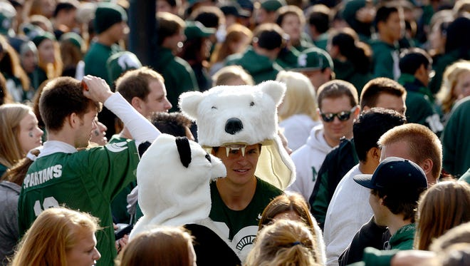 Students clad in a Polar and Panda bear suits wait to enter Spartan Stadium Saturday, September 12, 2015 before the Michigan State vs. Oregon game in East Lansing, Michigan.