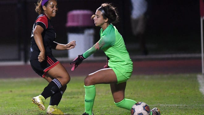 Vero Beach's Chayse McGirt puts the ball by Boca Raton goalkeeper Lara Larco in the first half of Tuesday's 7A-Region 3 championship. Vero Beach beat Boca Raton 1-0.