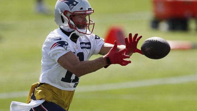 New England Patriots wide receiver Julian Edelman (11) makes a catch during an NFL football training camp practice, Friday, Aug. 21, 2020, in Foxborough, Mass.