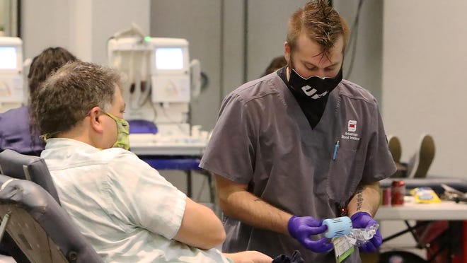 Arkansas Blood Institute phlebotomist Scott Brewer works with a blood donor, Tuesday, Nov. 17, during the ABI emergency blood drive in the UAFS Smith-Pendergraft Campus Center. The blood drive continues, Wednesday, Nov. 18, i0:30 a.m. to 3:30 p.m. in t.