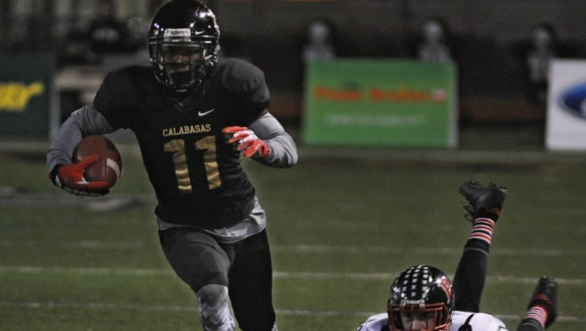 Calabasas receiver/defensive back Darnay Holmes was named the area's co-MVP, with teammate Tristan Gebbia, by the Ventura County Coaches Association.