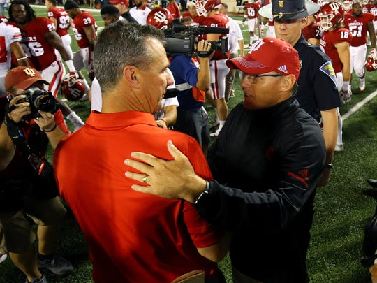 Ohio State Buckeyes head coach Urban Meyer (left) greets Indiana Hoosiers head coach Tom Allen (right) after their game at Memorial Stadium.