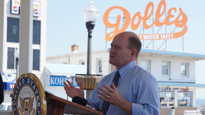 Sen. Chris Coons, D-Delaware, speaks in Rehoboth Beach Monday about a bill he co-sponsored to increase federal funding for a program giving small-business owners free entrepreneurial advice.