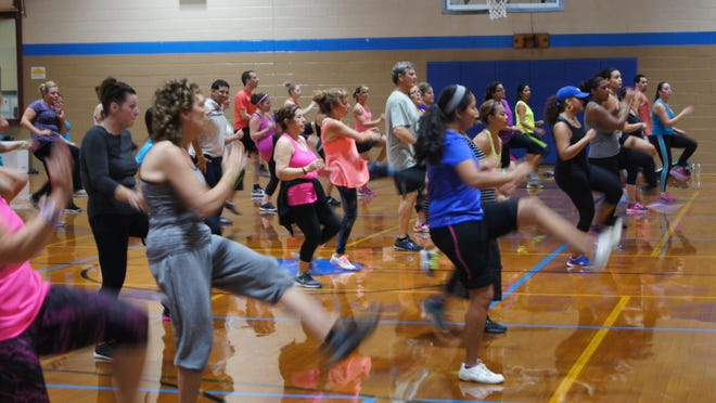 Zumba partygoers show their enthusiasm for the event.
