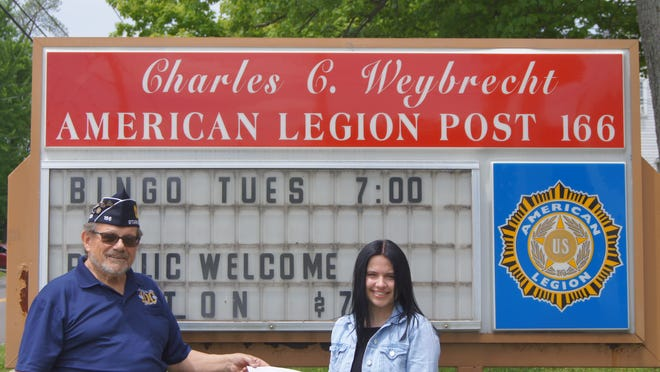 Post 166 Commander Ted Pase presents a $500 scholarship check to Savannah Heller, the American Legion Post 166/AHS Female Student of the Year.