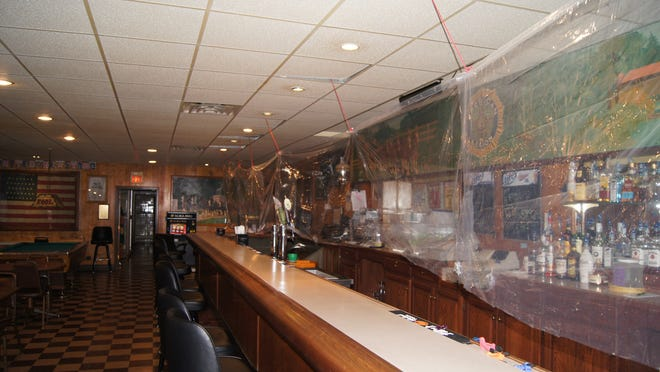 A temporary shield has been placed over the length of the bar at American Legion Post 166 grill as a precaution to protect the patrons and the bartenders. Several bar stools have been removed in order to adhere to the social distancing required by current state health department mandates.