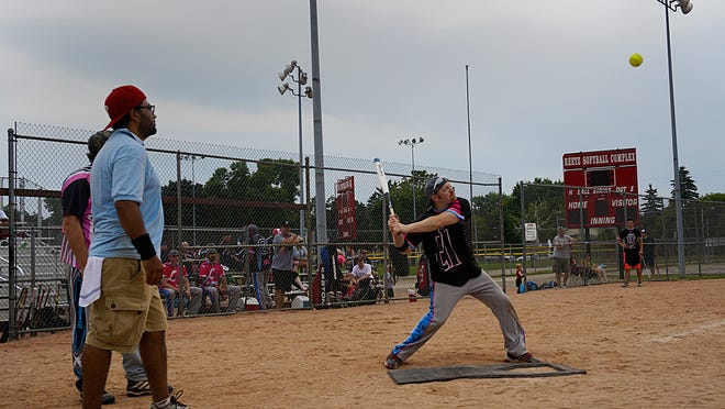 Jackie's Parkside takes a swing at bat during Real Men Wear Pink's softball tournament, July 12.