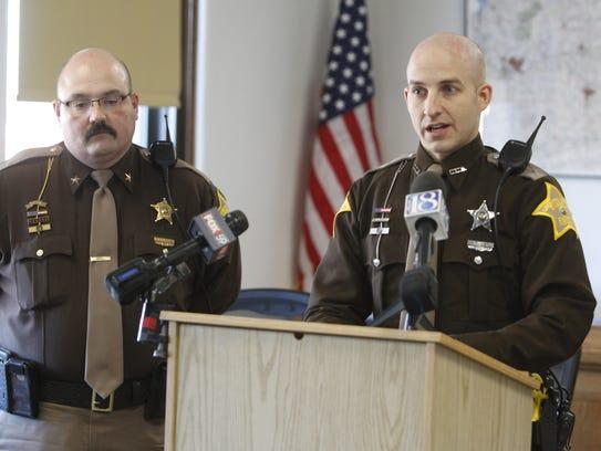 Caroll County Sheriff's Deputy Drew Yoder (right) speaks