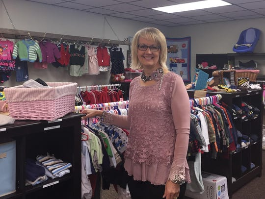 Echoz Pregnancy Care Center CEO Bonnie Mitchell stands
