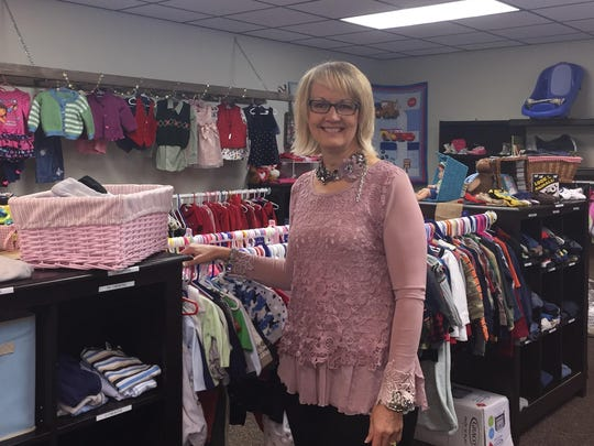 """Echoz Pregnancy Care Center CEO Bonnie Mitchell stands in the """"baby boutique,"""" which has everything from playpens to clothing up to size 6. Parents can earn the items for their families by participating in parenting classes."""