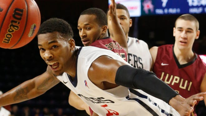 Richmond's Terry Allen, foreground, chases down a loose ball during an NCAA college basketball game against IUPUI in Richmond, Va., Tuesday, Dec. 23, 2014.  Watching the play, from second left, are IUPUI's P.J.Boutte, Richmond's Alonzo Nelson-Ododa and IUPUI's Josh James. (AP Photo/Richmond Times-Dispatch, Joe Mahoney)