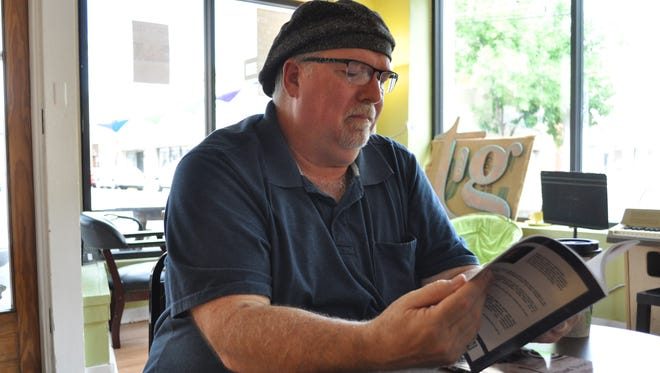 """David Atwood reads from his latest book of poetry """"Catfish Bones and Cajun Ghosts"""" at Tamp and Grind Coffee Shop."""