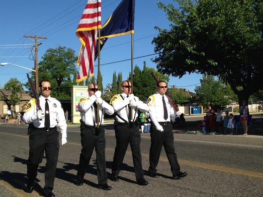 The Washington County Fair parade began with members of the Washington County Sheriff's Office Honor Guard on Saturday, Aug. 9, 2014.