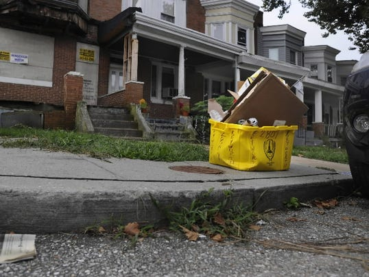 Have you seen my recycle bin? Photo courtesy of the Associated Press.