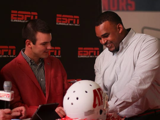 Austin Peay coach Will Healy, left, and co-defensive coordinator Marcus West FaceTime with players as they send in their national letters of intent.