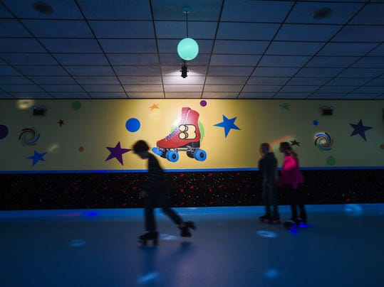 Kids skate around the track at Magic Elm Skateland on Nov. 19. The Black Rose Rollers roller derby team will host an event at the rink this weekend.