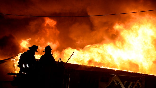 Fire crews from three counties battle a massive blaze at Acorn Manufacturing at 24 Terry Lane in South Londonderry Township on Thursday, November 5, 2015. Water had to be trucked in by tankers to extinguish the blaze that engulfed a 55,000 square foot structure  Jeremy Long -- Lebanon Daily News