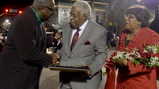 Dr. Melvin Wright is presented with a plaque during the 2015 City of Jackson Christmas Parade. Wright was the grand marshal of the parade.