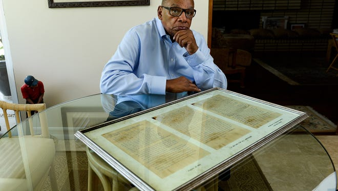"""Former University of Iowa men's basketball coach  George Raveling with a copy of Martin Luther King's famous """"I have a dream speech"""" made on August 28, 1963, on the steps of the Lincoln Memorial during the March on Washington for Jobs and Freedom."""