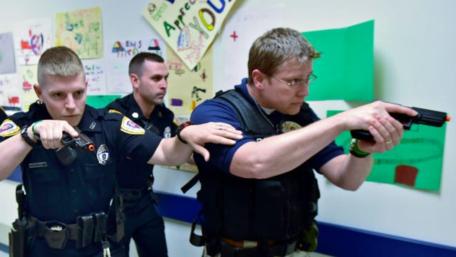 Chambersburg Police enter the hallway to conduct an active shooter drill Thursday morning, May 26, 2016 at Chambersburg Hospital.