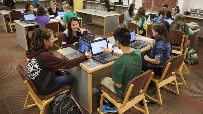 Concord High School students work on laptops. The Brandywine School District, which includes Concord, is part of a group of districts buying technology together to save money.