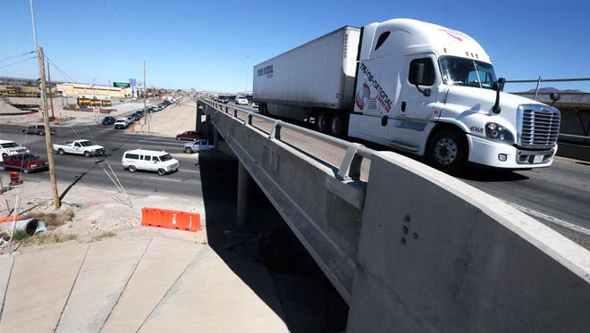 Traffic flows over and under the Interstate 10 east overpass at N. Mesa Street in West El Paso Tuesday.