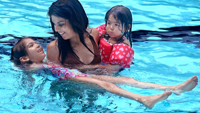 In this 2010 file photo, Teresa Caamano swims with her two young daughters, Thalia, 6, left, and Sofia, 4, at the Spratt Park pool on Wilbur Boulevard in the city of  Poughkeepsie. The City of Poughkeepsie announced the pool will be closed for a few days due to a filter malfunction.