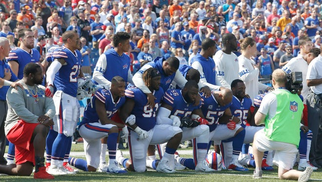 Members of the NFL's Buffalo Bills kneel in protest during the national anthem before a game against the Denver Broncos on Sept. 24.