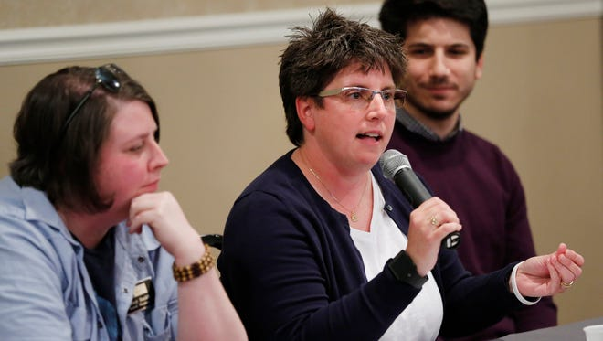 Kim Simes speaks during a town hall meeting for members of the local LGBTQ community to express concerns about the Religious Freedom Restoration Act (RFRA) Monday, April 6, 2015, at Columbia Ballroom, 625 Columbia Street in downtown Lafayette. Simes, who is Midwest Regional Manager, Family Equality Council, said not once leading up to the passage of RFRA did she hear how the law was going to affect children. Simes said RFRA impacts the entire family.