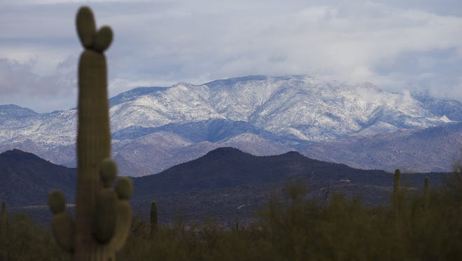 Snow covers mountains northeast of Phoenix after a storm Dec. 14, 2015.