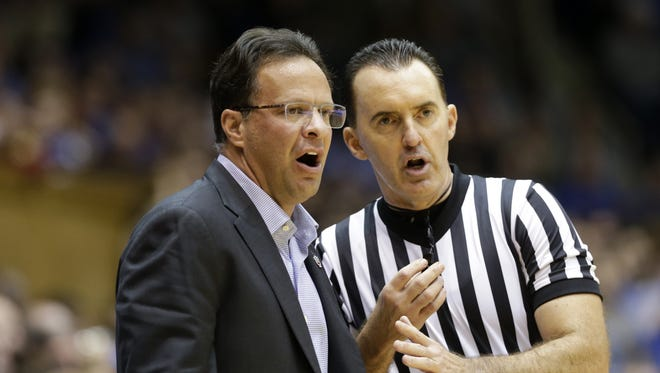 Indiana coach Tom Crean speaks with an official during the first half of an NCAA college basketball game against Duke in Durham, N.C., Dec. 2, 2015.