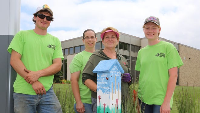 Students show off one of three new custom-built butterfly houses on FVTC's Appleton campus