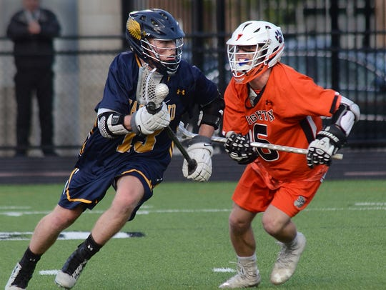 Hartland's Jake Gallaher (left) is defended by Brighton's